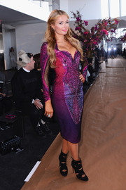 Paris Hilton sported an eye-catching blend of colors in this sequin and mesh dress during the Gabriela Cadena fashion show.