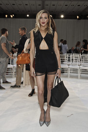 Katie Cassidy turned heads at the Gabriela Cadena fashion show in a black romper with a gaping cutout.