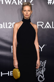 Karolina Kurkova brightened up her black look with a yellow velvet purse when she attended the Angel Ball 2017.