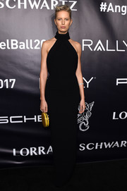 Karolina Kurkova was minimalist-elegant in a fitted black halter gown at the Angel Ball 2017.