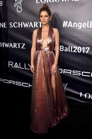 Maria Menounos sent temperatures rising with this cleavage-flaunting rose-gold empire gown by Maria Lucia Hohan at the Angel Ball 2017.