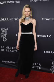 Andreja Pejic oozed glamour at the Angel Ball 2016 in a black velvet slip dress with a bedazzled waistband.