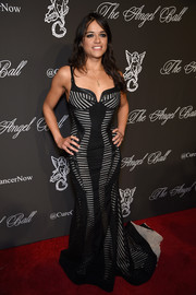 Michelle Rodriguez went for a vampy look in a black-and-white corset gown during the Angel Ball.