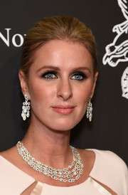 Nicky Hilton accessorized with a pair of diamond chandelier earrings by Avakian for a totally glamorous look.