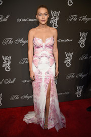 Gigi Hadid attended the Angel Ball rocking a princess-with-an-edge look in a floral strapless gown with skeleton-like detailing on the bodice.