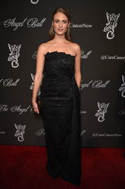 Julie Henderson chose a shimmery black strapless gown with origami detailing along the bustline for the Angel Ball.