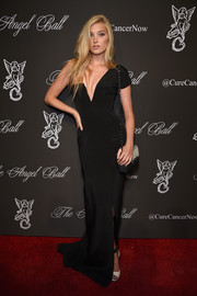 Elsa Hosk showed off her fabulous physique in a slinky black one-shoulder gown during the Angel Ball.