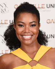 Gabrielle Union gathered her curls in a ponytail for the launch of her collection with New York & Company.