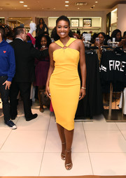 Gabrielle Union looked summery in a canary-yellow halter dress at the launch of her collection with New York & Company.