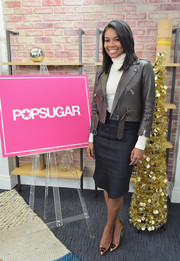 Gabrielle Union wore a gray leather jacket over a white polo neck sweater to the Popsugar Studios.