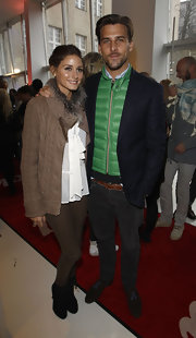 Johannes Huebl chose a green puffa jacket to pair under a blazer for a cool but casual look at Berlin Fashion Week.
