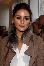 Olivia Palermo attended fashion week in Berlin looking radiant, with dewy skin and soft makeup.