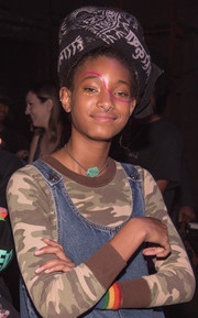 Willow Smith attended GIRLCULT wearing a printed scarf around her hair.