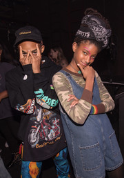 Willow Smith layered a denim romper over a camo shirt for her GIRLCULT look.