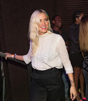 Ashlee Simpson was demure in a high-neck white blouse and black trousers while attending GIRLCULT.