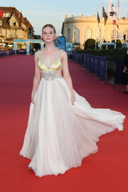Elle Fanning looked absolutely enchanting in a bow-embellished cutout gown by Miu Miu at the Deauville American Film Festival premiere of 'Galveston.'