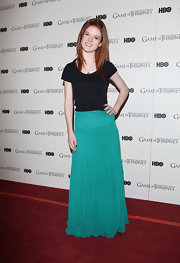 Rose Leslie's teal maxi skirt burst with bold color.