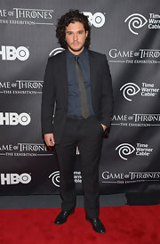 Kit Harington chose a classic men's suit with this navy, notch-lapel piece.