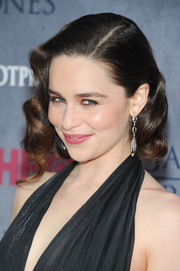 Emilia Clarke complemented her 'do with a pair of dangling diamond earrings by Fred Leighton for an even more elegant look.