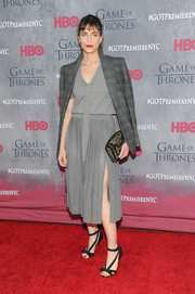 Amanda Peet chose an animal-print clutch to top off her ensemble.