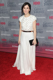 Sibel Kekilli was demure and elegant at the 'Game of Thrones' season 4 premiere in a belted white evening dress with cap sleeves and an embroidered bodice.