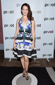 Kristin Davis paired her cute dress with black gladiator heels.