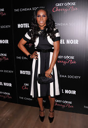 June Ambrose matched her high-contrast A-line dress with a satin purse with bead embellishments.