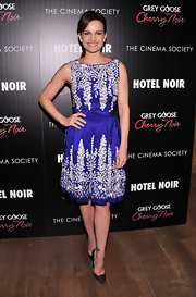 Carla stuck with her classy retro aesthetic in this blue embroidered frock at the 'Hotel Noir' screening.