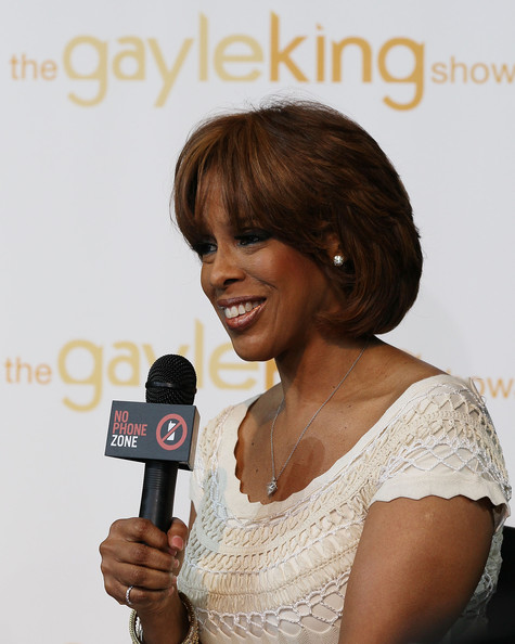 Gayle King Bob [hair,microphone,hairstyle,audio equipment,singer,brown hair,electronic device,long hair,singing,lace wig,mobile phones,gayle king,drivers,use,ray lahood attends,driving,cell phone use,number,rally,rally]