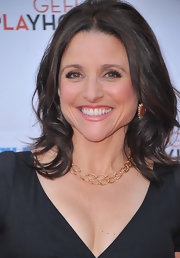 Julia Louis-Dreyfus dressed up her look with a layered chainlink necklace and a pair of dangling earrings when she attended the Backstage at the Geffen gala.