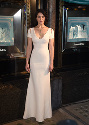 For the 2015 Tiffany & Co. Christmas window reveal, Gemma Arterton donned a low-cut, shoulder-cutout gown that displayed her figure to perfection.