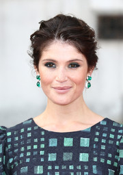 Gemma Arterton played down her kissers with nude lipstick.