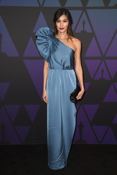 Gemma Chan Satin Clutch [dress,fashion model,gown,cocktail dress,formal wear,model,beauty,shoulder,fashion show,bridal party dress,gemma chan,hollywood highland center,california,the ray dolby ballroom,academy of motion picture arts and sciences,10th annual governors awards,governors awards]