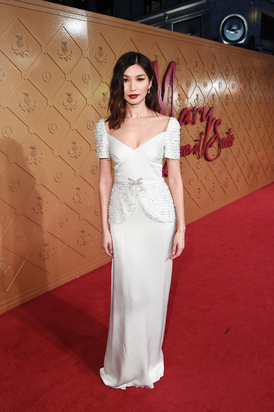 Gemma Chan Beaded Dress [mary queen of scots,gemma chan,clothing,dress,gown,shoulder,red carpet,carpet,fashion model,flooring,lady,hairstyle,premiere,european premiere of mary queen of scots,european,london,england,cineworld leicester square]