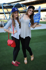 Sophie Simmons attended the Dodgers game wearing a sheer halter top and a pair of skinny jeans.