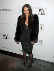 Kim Kardashian rounded out her all-black ensemble with Kardashian Kollection tights and Tom Ford strappy sandals.