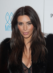 Kim Kardashian wore her hair loose with a center part and just a hint of a wave during the Generation NXT charity benefit.