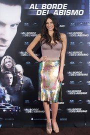 Genesis Rodriguez smiled from ear-to-ear at a movie photocall wearing a plain tank top and a colorful sequined skirt.