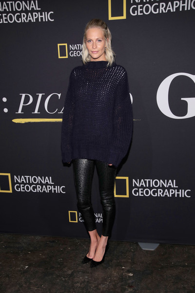 Poppy Delevingne teamed her sweater with a pair of leopard-patterned lambskin pants by RtA.