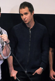 Sam wore a zip-front navy knit cardigan while on stage at Tribeca Cinemas in NYC.