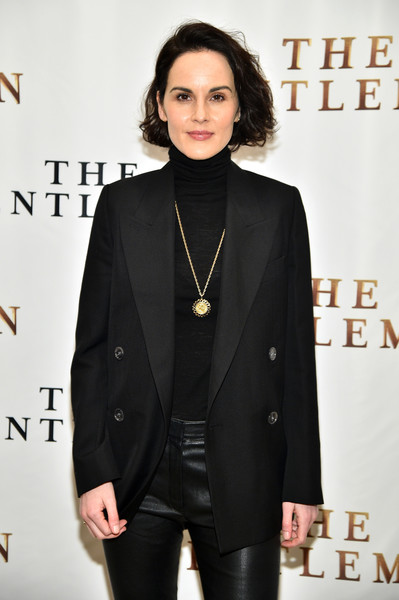 Michelle Dockery punctuated her black outfit with a gold pendant necklace for the New York photocall for 'The Gentlemen.'