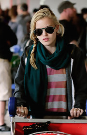 Georgia May Jagger looked cute and cozy in her scarf and cardigan. The up and coming model topped off her look with a side braid and aviator shades.