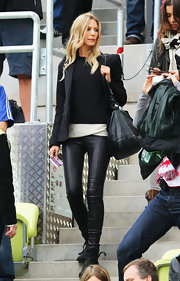 Sarah Brandner looked edgy from the waist down in black leather pants and biker boots during a football match.