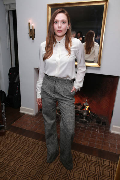 Elizabeth Olsen kept it simple and classic in a white silk button-down at the Gersh Oscar party.