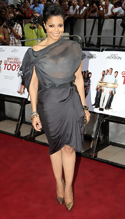 Janet gave us a bit of a peepshow, wearing a draped gray ensemble featuring a very sheer organza top.