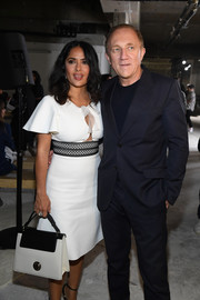 Salma Hayek arrived for the Giambattista Valli fashion show carrying a black-and-white single-strap tote from the brand.