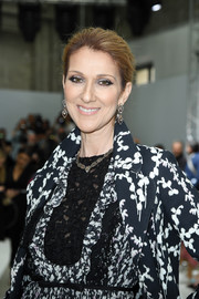 Celine Dion pulled her tressed back into a loose bun for the Giambattista Valli Couture show.