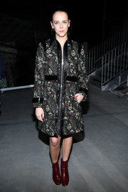 Pauline Ducruet donned a leather-trimmed print coat by Giamba for the Giambattista Valli Fall 2018 show.