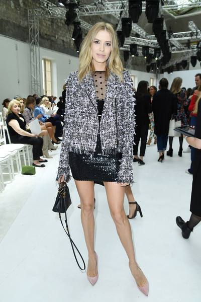 Elena Perminova attended the Giambattista Valli Couture show wearing a speckled tweed jacket over a little black dress.