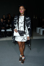 Janelle Monae kept it classy in a monochrome printed peplum top, skirt, and coat combo by Giambattista Valli during the brand's fashion show.